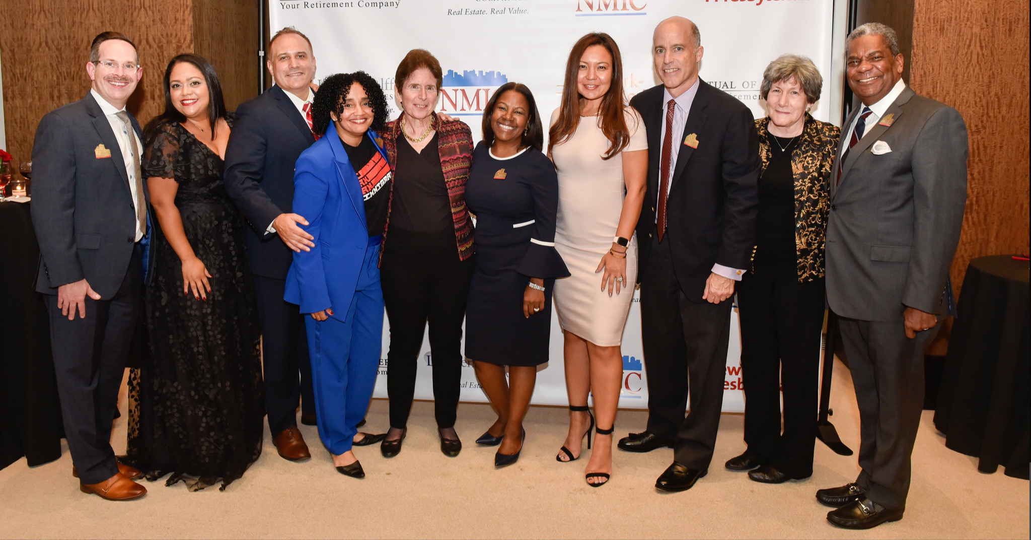 A photo of NMIC's board of directors with ED, Maria Lizardo.
