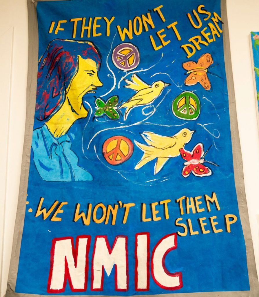 "An immigration sign that reads ""If they won't let us dream, we won't let them sleep, NMIC"""